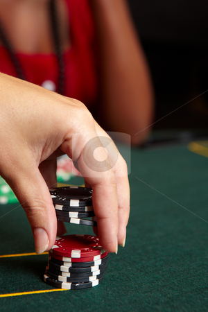 Card gambling stock photo, Playing cards, chips and players gambling around a green felt poker table. Shallow Depth of field, focus on red chips by Sean Nel