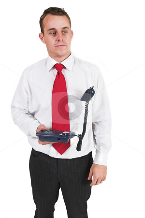 Tollie Booysen #12 stock photo, Businessman in black pants, white shirt and red tie. Holding phone - headset in pocket by Sean Nel
