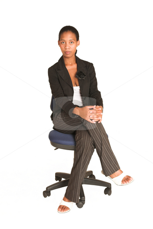 Mida Matsimela #30 stock photo, African business woman dressed in black jacket. Sitting on office chair by Sean Nel