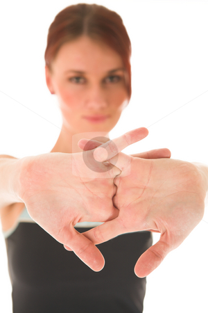Gym #78 stock photo, Woman streching. Deth of field, hands in focus, face out of focus. by Sean Nel