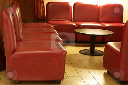 Interior of a hotel in Paris stock photo, The interior of a hotel with tiled floors and leather couches in Paris, France. by Sean Nel
