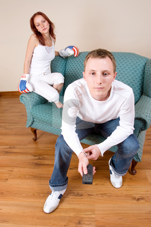 Couple #47 stock photo, Woman hitting her boyfriend with boxing gloves by Sean Nel