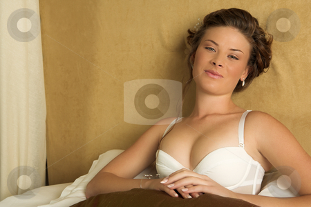 Lingerie#265 stock photo, Woman in underwear sitting on a bed. by Sean Nel