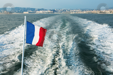 IsleDeMarguerite #4 stock photo, Leaving the Harbour in Cannes, France on a speedboat - French flag blowing in the wind by Sean Nel