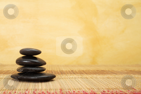 Massage #38 stock photo, Hot stone massaging stones on bamboo cloth in front of wall - copy space by Sean Nel