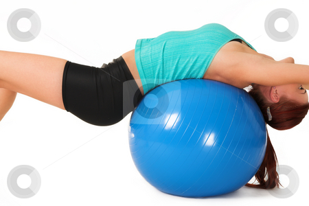 Gym #12 stock photo, A woman in gym clothes, laying on her back on a Pilates ball by Sean Nel