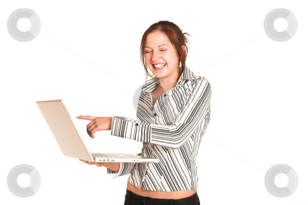 Business Woman #351 stock photo, Business woman with brown hair, dressed in a white shirt with black stripes.Pointing at a laptop, laughing.  copy space by Sean Nel