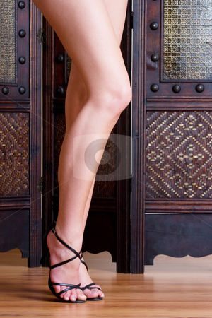 Legs #2 stock photo, Beautiful, long legs with black sandals on a wooden floor by Sean Nel