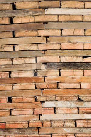 Wood Pile stock photo, Pile of stacked wood in a workshop by Sean Nel