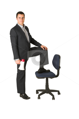 Businessman #250 stock photo, Businessman wearing a suit and a grey shirt.  Making a stunt on an office chair with a megaphone in his hand. by Sean Nel