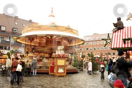 Merry go round stock photo, Merry-go-round in Neurenburg - Munich. Movement on people and merry-go-round. by Sean Nel