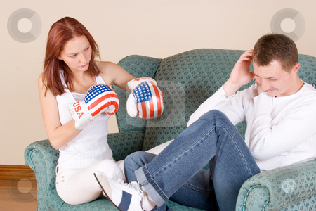Couple #40 stock photo, Woman hitting her boyfriend with boxing gloves by Sean Nel