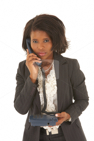 Sexy african businesswoman stock photo, Sexy young adult african businesswoman in a business suit on a white background with a telephone. NOT ISOLATED by Sean Nel