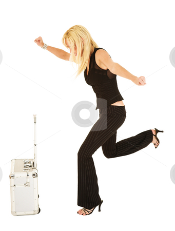 Blonde businesswoman in black kicking luggage stock photo, Blonde frustrated businesswoman in black trousers kicking luggage - isolated on white - movement on back foot by Sean Nel