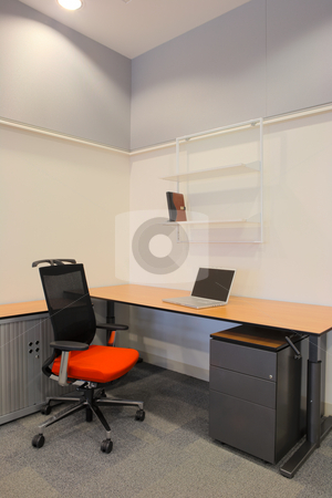 Interior of a new office stock photo, Empty office with new modern office furniture, including desks, cupboards, filing cabinets and chairs. Two orange chairs facing out. HDR type image by Sean Nel