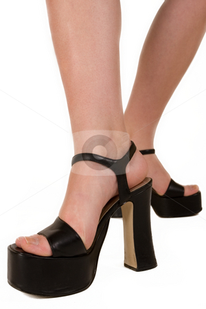 Fashionable feet 2 stock photo, Ladies feet in black high sole shoes by Sean Nel