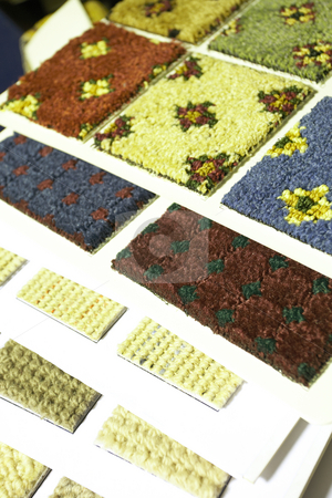 Carpet texture swatches and samples stock photo, Colorful material swatches and samples for carpeting as used by interior decorators (shallow Depth of Field ? focus on red and green swatch) by Sean Nel