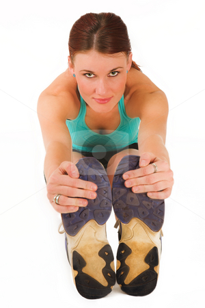 Gym #18 stock photo, A woman in gym clothes, stretching by Sean Nel