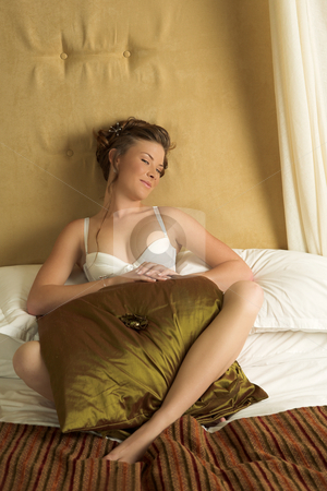 Lingerie#266 stock photo, Woman in underwear sitting on a bed. by Sean Nel