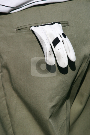 Golf glove stock photo, Golfers glove hanging from his back pocket by Sean Nel