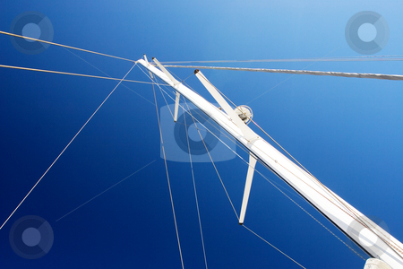 Boat #4 stock photo, White Yacht sail and radio mast with rolled sails by Sean Nel