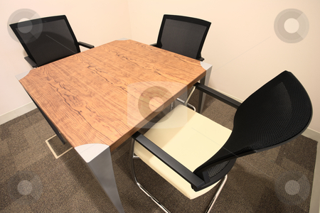 Interior of a new office stock photo, Empty office boardroom with new modern office furniture, a table and three chairs. HDR type image by Sean Nel