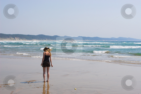 Sudwana #10 stock photo, A woman walking on the beach, picking up shells by Sean Nel