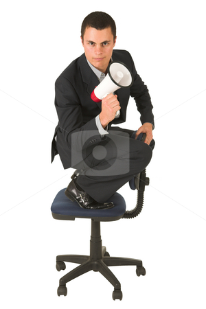 Businessman #249 stock photo, Businessman wearing a suit and a grey shirt.  Making a stunt on an office chair with a megaphone in his hand. by Sean Nel