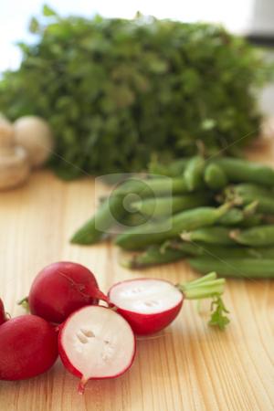 Fresh vegetables on cutting boardFresh vegetables on cutting bo stock photo, A variety of vegetables on a wooden cutting board, including parsley, radish, beans and mushrooms by Sean Nel