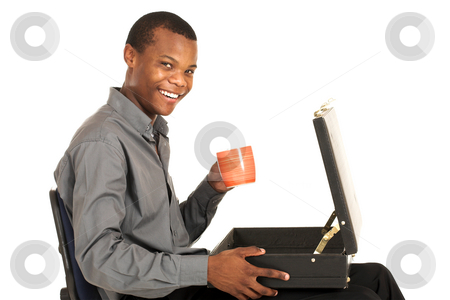 Businessman #160 stock photo, Businessman in grey shirt sitting on an office chair, with suitcase on his lap holding a cup.  Copy space. by Sean Nel