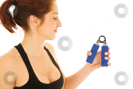 Sexy redhead woman in gym clothes stock photo, Sexy young adult woman in black gym outfit isolated on white. She is working with hand exercise training equipment and is smiling by Sean Nel