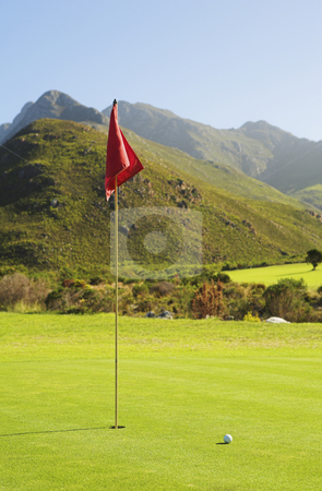 Golf #49 stock photo, Red flag in golf hole. by Sean Nel