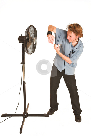 David Badenhorst #12 stock photo, Man with blue shirt cooling down in front of a fan. by Sean Nel