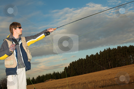 Flyfishing #15 stock photo, A fly fisherman casting a line in Dullstroom, South Africa - Focus on hands and rod by Sean Nel
