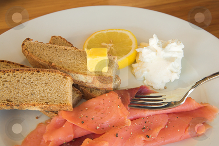Lunch #17 stock photo, Whole wheat bread with salmon, lemon and cream on a plate by Sean Nel