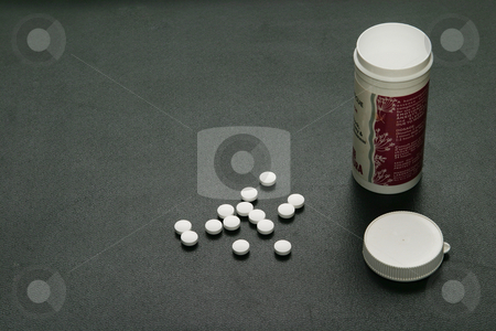 Pills and a bottle stock photo, Medication in a botttle by Sean Nel
