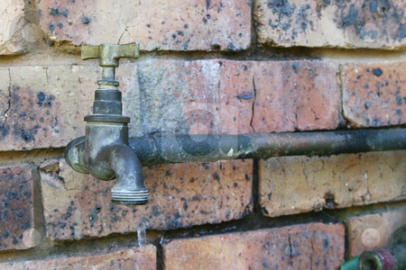 Old water tap stock photo, Old outdoor watertap by Sean Nel