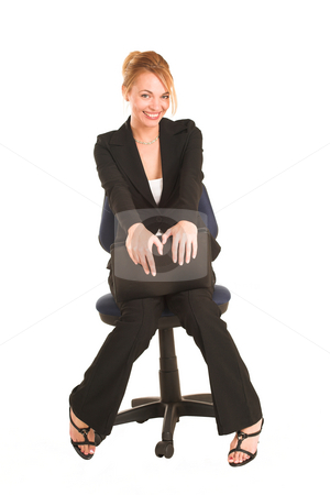 Businesswoman #265 stock photo, Blonde business lady in formal black suit. Sitting on an office chair, holding a file. by Sean Nel
