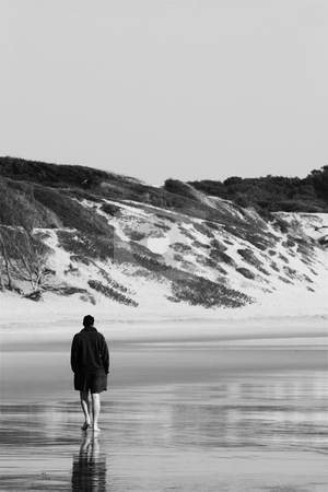 Sudwana #22 stock photo, Man walking on the beach. by Sean Nel