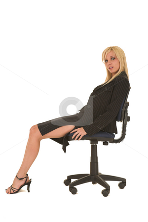 Sexy blonde businesswoman stock photo, Sexy young adult Caucasian businesswoman in black pinstripe pencil skirt and suit jacket on a white background, sitting on an office chair by Sean Nel