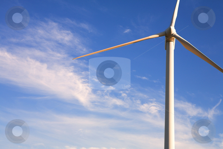 Wind powered turbine stock photo, Wind powered electricity generator standing against the blue sky by Sean Nel