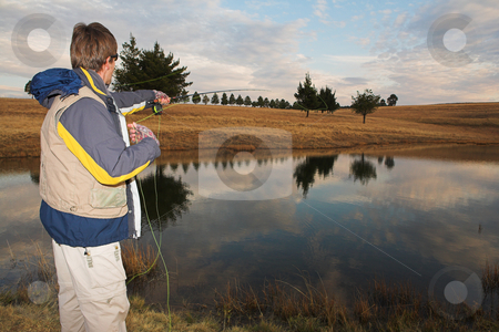 Flyfishing #14 stock photo, A fly fisherman casting a line in Dullstroom, South Africa by Sean Nel