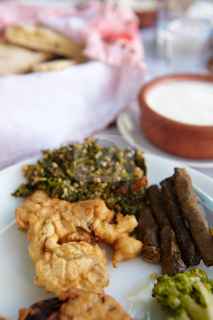Traditional Turkish meal stock photo, Traditional Turkish meal of steamed broccoli, potato dumplings, homemade flat bread and dolmati. Very shallow Depth of Field. by Sean Nel