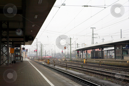 Neurenburg side view of railway tracks stock photo, Train station in Neurenburg, Germany. by Sean Nel