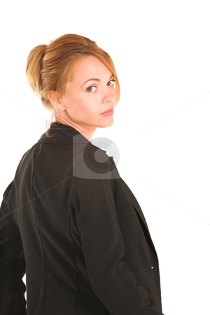 Businesswoman #233 stock photo, Blonde business lady in formal black suit.  Looking over her shoulder.  Portrait by Sean Nel