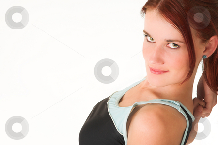 Gym #32 stock photo, A woman in gym clothes, stretching by Sean Nel