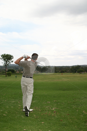 Hitting the bal stock photo, Player hitting a golf ball down the fairway by Sean Nel