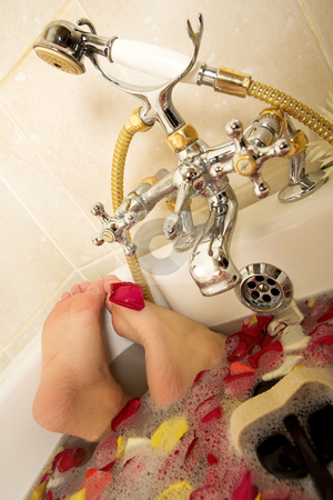 Woman #195 stock photo, Feet of a woman in a bath. by Sean Nel