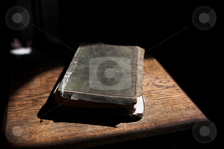 Leather covered bible lying on a table  stock photo, Leather covered old bible lying on a wooden table in a beam of sunlight (not an isolated image) Shallow Depth of field  by Sean Nel