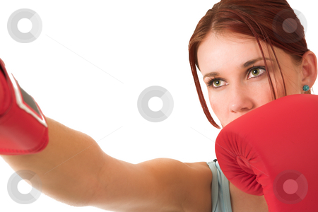 Gym #67 stock photo, Woman boxing, depth of field.  Face in focus, gloves out of focus. by Sean Nel